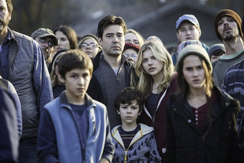 """Ron Livingston, center left, and Chloë Grace Moretz, center right, and Zackary Arthur, below center, star in Columbia Pictures' """"The 5th Wave."""""""