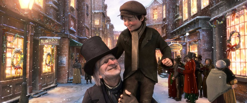 Scrooge (JIM CARREY) left, TINY TIM (Gary Oldman), right